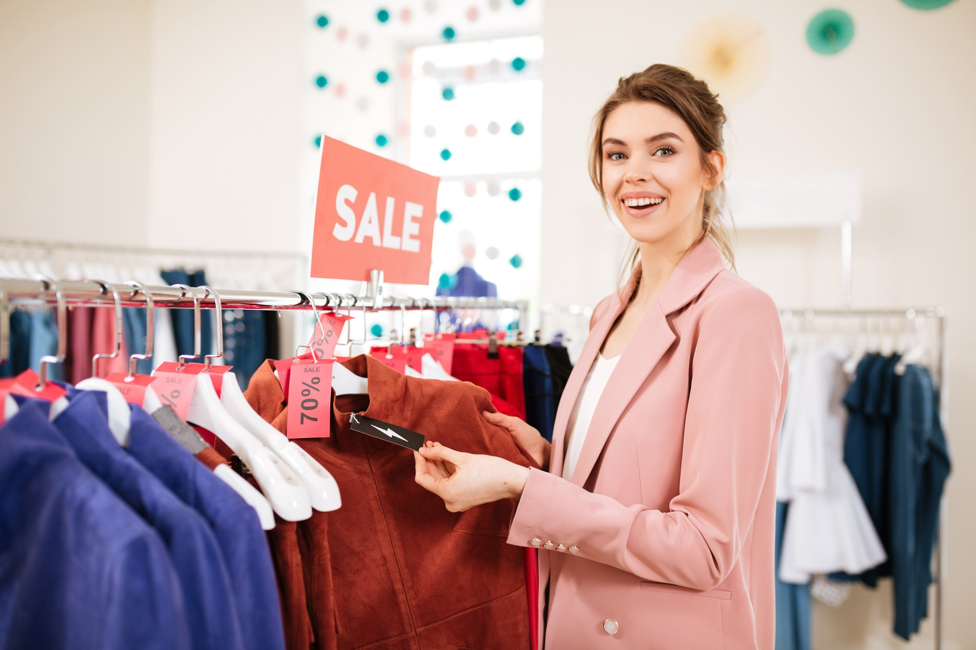 Smiling lady that find something on sale in clothes store